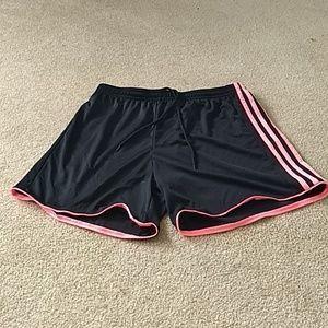 Peach and black adidas shorts